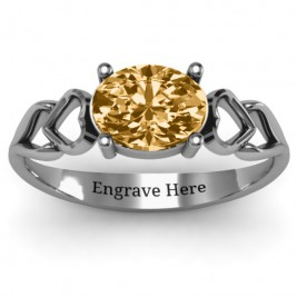 Oval Solitaire Ring with Surrounding Hearts